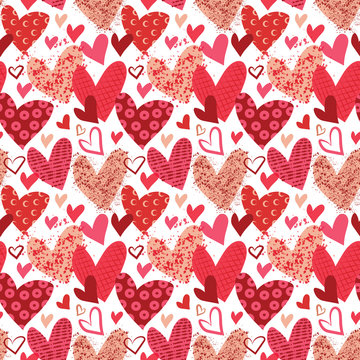 Valentine's Day print. Whimsical doodle heart seamless pattern. Repeating pattern for cards, gift wrap, backgrounds, scrapbook paper and more. Red and pink patterned hearts. Hand drawn doodle.