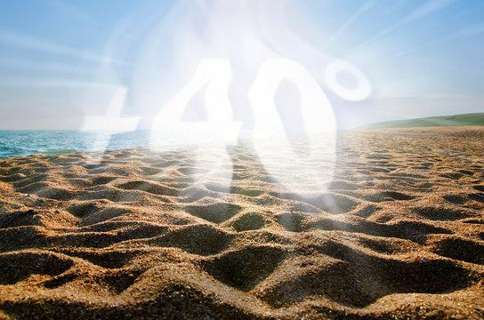 The inscription +40 degrees evaporates on the seashore