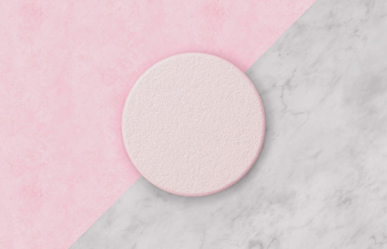 Empty pink cylinder box on Duotone background with marble stone texture for product display. Minimal spring summer concept. Flat lay. Top view.