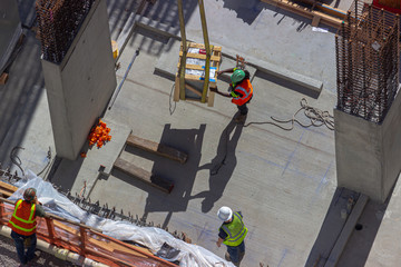 construction workers at a large building site