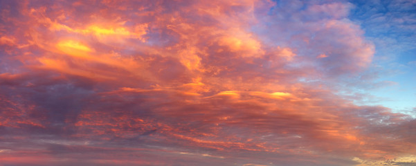 In de dag Lavendel beautifully lit clouds during sunrise