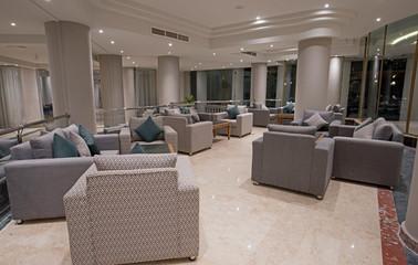 Interior design of lobby seating area in luxury hotel