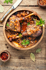 Spoed Fotobehang Grill / Barbecue Roasted duck leg with apple sauce