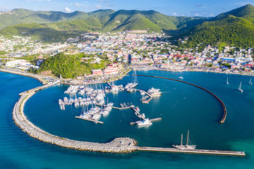 Arial view of Marigot, the main town and capital in the French Saint Martin, sharing the same island with dutch Sint Maarten. Fort St. Louis on a hill, yachts and a circular breakwaters of the marina