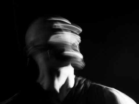 Portrait of a  man screaming in soft focus and long exposure