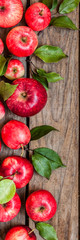 Red Apples on Old Wood Background