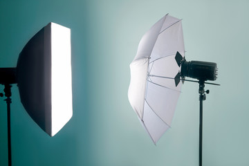 The light equipment of photo studio, on blue background. Isolated, copy space for any text. Wall mural
