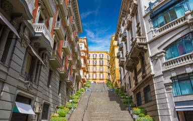 Fotobehang Napels Wide angle photo of italian street with stairs leading up without people in Naples, Italy taken on sunny day.