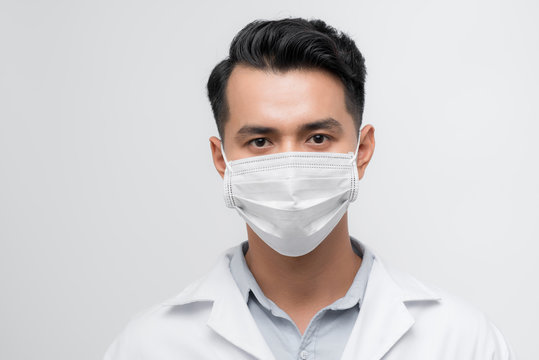 Handsome doctor portrait with a white coat, face mask