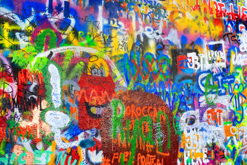 Bright colorful John Lennon's wall with graffiti in Prague