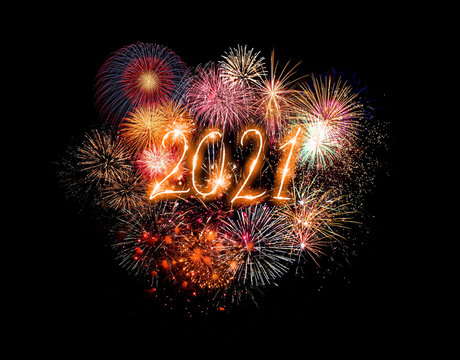 Happy new year greeting card with 2021 golden numbers and fireworks series on dark background with empty space for text