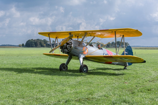 Historical airplane with pilot is ready to take off