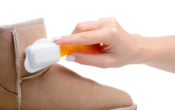 Shoe brush for cleaning suede leather shoes on white background isolation