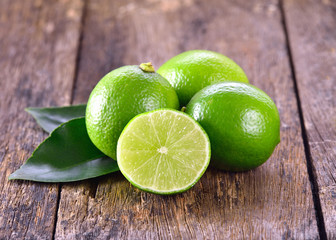 Lime on wooden background Wall mural