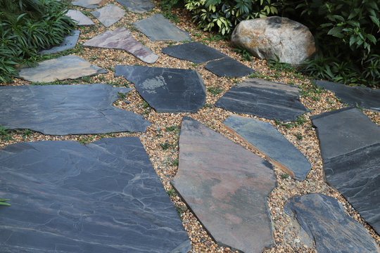 Closeup of classical designed stones pathway in the garden.