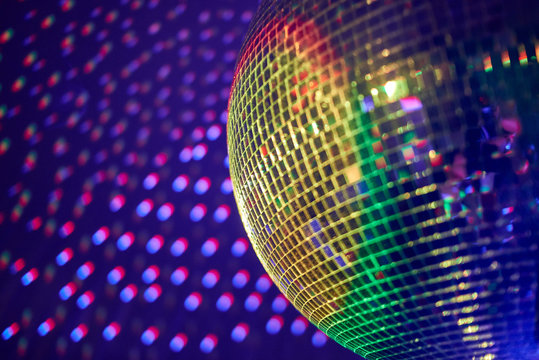 nightclub disco ball with colorful reflections