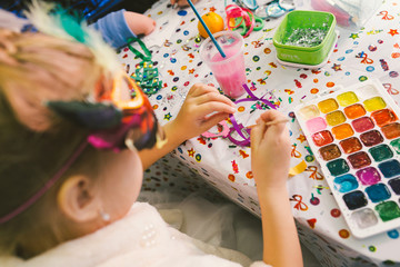 Children's developing charity holiday, where kids and teenagers draw watercolor pictures and postcards. Children in the creative process