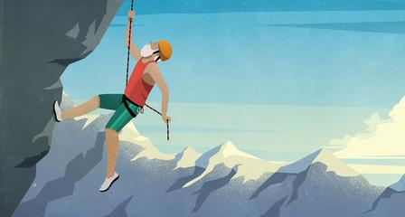 Senior male mountain climber scaling rock face