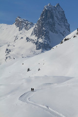 People snowshoeing on sunny, snow covered mountain, Vals, Canton of Grisons, Switzerland