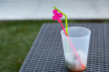 Fresh summer cocktail with ice cubes. Glass of lemonade soda drink. drink in a pool