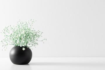 Home interior floral decor. Elegant floral soft composition. Beautiful flowers gypsophila in black...