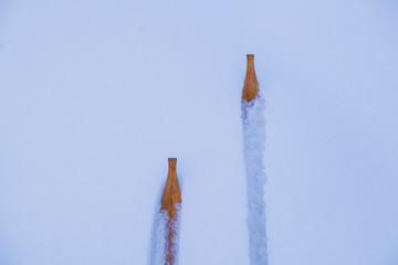 Wooden skis on snow