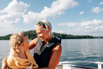 Mother with daughter on boat