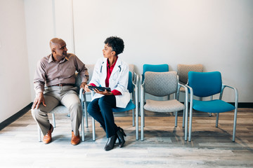 Doctor consulting  mature medical patient