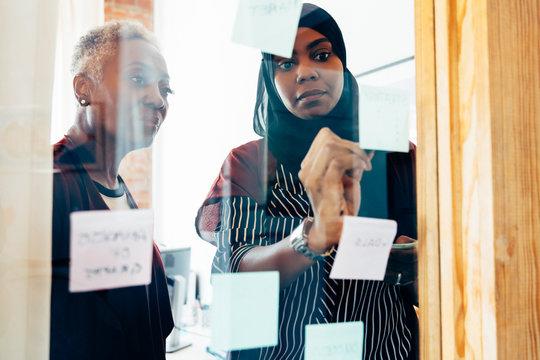 Diverse team brainstorming in meeting
