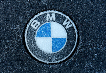 BMW sign with ice crystals on a Vehicle. BMW is a famous German automobile, motorcycle and engine manufacturing company
