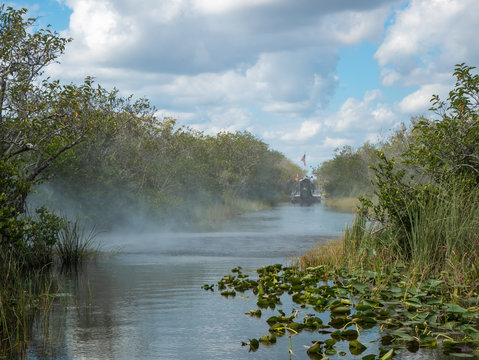Air boat exhaust and wake with another air boat in the channel at Everglades National Park, Florida.