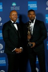 Jamie Foxx poses backstage with Bryan Stevenson after receiving the Spotlight Award at the 2020 Palm Springs International Film Festival Awards Gala in Palm Springs
