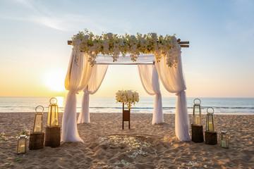beach ceremony setup with Golden light sunset