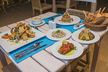 Seafood meal setting in a la carte outdoor restaurant