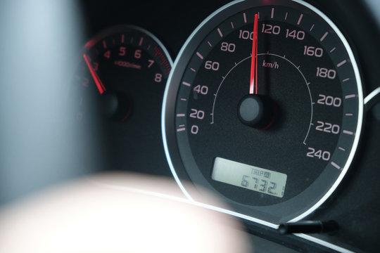 closeup side view of speedometer 120 kph speed