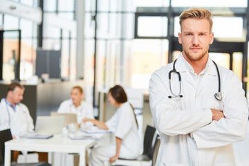 Young man as a doctor with crossed arms