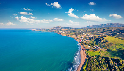 Zelfklevend Fotobehang Kust View from flying drone. Aerial morning view of Sciacca town, province of Agrigento, southwestern coast of Sicily, Italy, Europe. Superb spring seascape of Mediterranean sea.