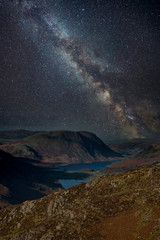 Self adhesive Wall Murals Chocolate brown Stunning majestic digital composite landscape of Milky Way over Haystacks and High Stile in Lake District