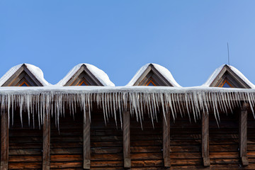 Hanging icicles on the roof edge