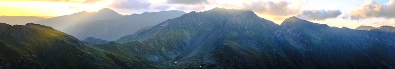 Sunrise on Fagaras high mountain ridge. Romanian mountain landscape with high peaks over 2200m