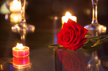 Wall Mural - Romantic mood with red rose and candle light's