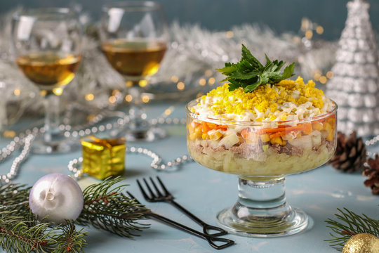 Holiday salad with canned fish, eggs, carrots and potatoes, Traditional Russian food, horizontal orientation