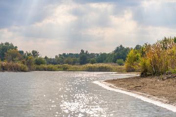 Rural nature river sky clouds landscape. Nature river shore. Country river landscape. River sky...