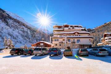 Car parked on road at Hintertux Glacier in Tyrol in Mayrhofen in Austria, winter Alps. Street...