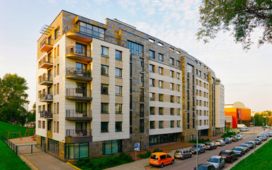 Apartment in residential building exterior. Housing structure at blue modern house of Europe. Rental home in city district on summer. Architecture for business property investment, Vilnius, Lithuania. Fotomurales
