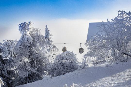 Gondola Rides at Mammoth Mountain ski area with snow background. Winter scenic in California.