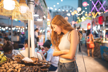 Poster Bangkok Traveler Asian blogger women travel in Bangkok, Thailand, beautiful female using .Travel vacation at night in the city concept, Young happy traveler asian woman and backpack walking