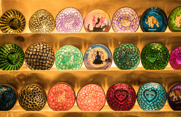 Close-up view of the colorful handicraft bowls selling in the souvenirs stall at Ratchada Rot Fai Train Night Market Bangkok,Thailand.