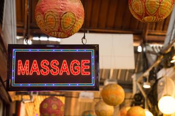 Red LED massage signage hanging at the Chatuchak weekend market,Bangkok Thailand.