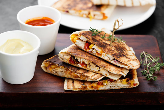 Mexican quesadilla with chicken meat,sweetcorn and pepper served with different sauces.
